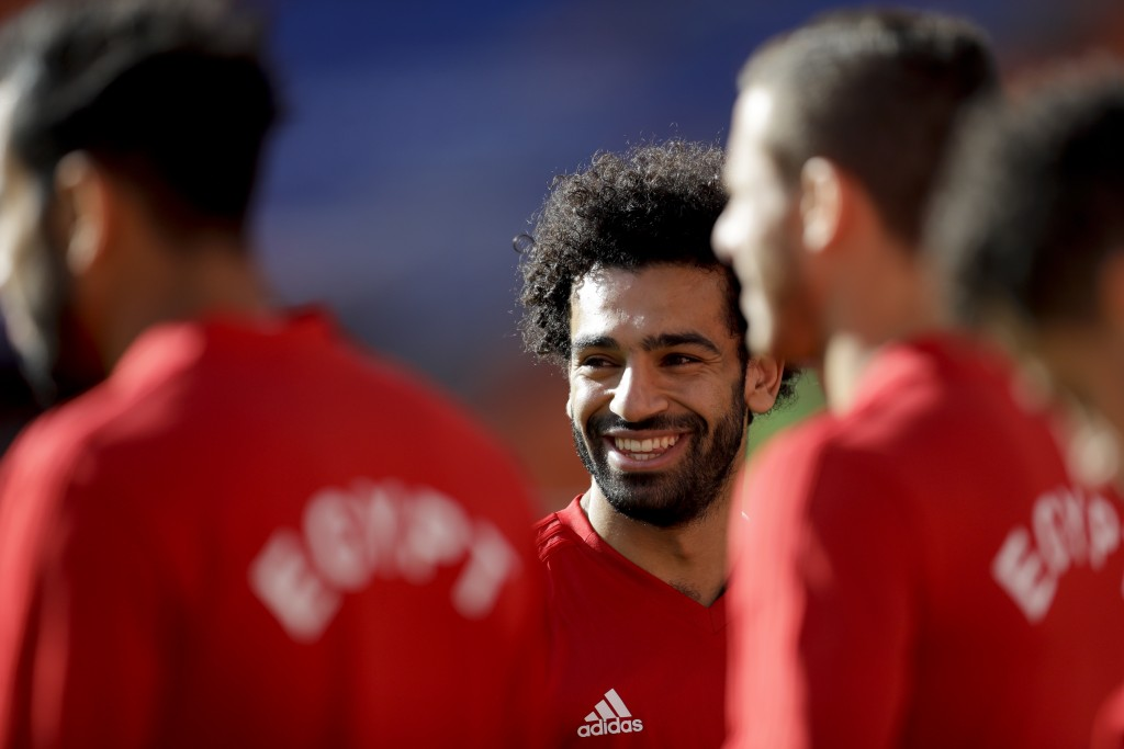 Egypt's Mohamed Salah smiles during Egypt's official training on the eve of the group A match between Egypt and Uruguay at the 2018 soccer World Cup i