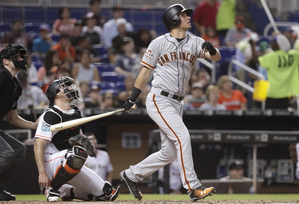 San Francisco Giants' Joe Panik watches his single during the fifth inning of a baseball game against the Miami Marlins, Wednesday, June 13, 2018, in