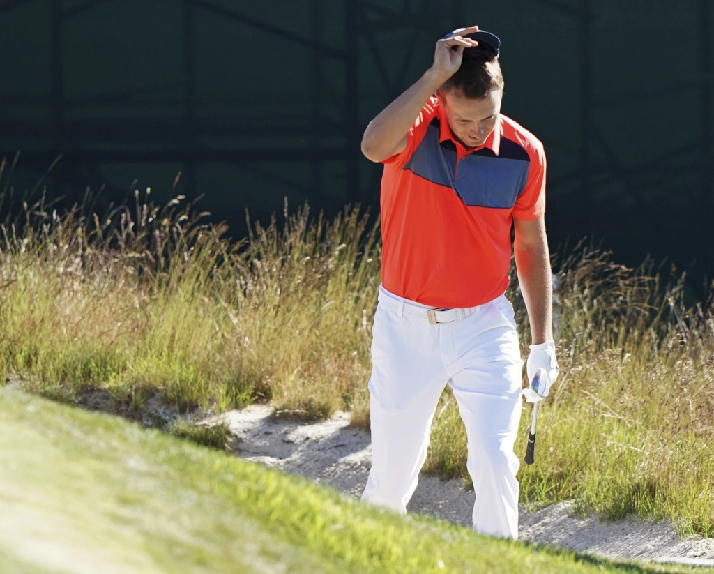 Jordan Spieth checks his lie in a bunker on the 11th hole during the first round of the U.S. Open Golf Championship, Thursday, June 14, 2018, in South