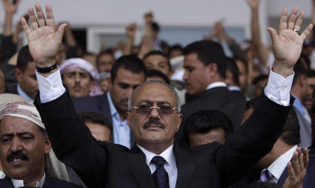 FILE - In this April 15, 2011, file photo, Yemen's then-President Ali Abdullah Saleh waves to his supporters during a rally in Sanaa, Yemen. Yemen's y