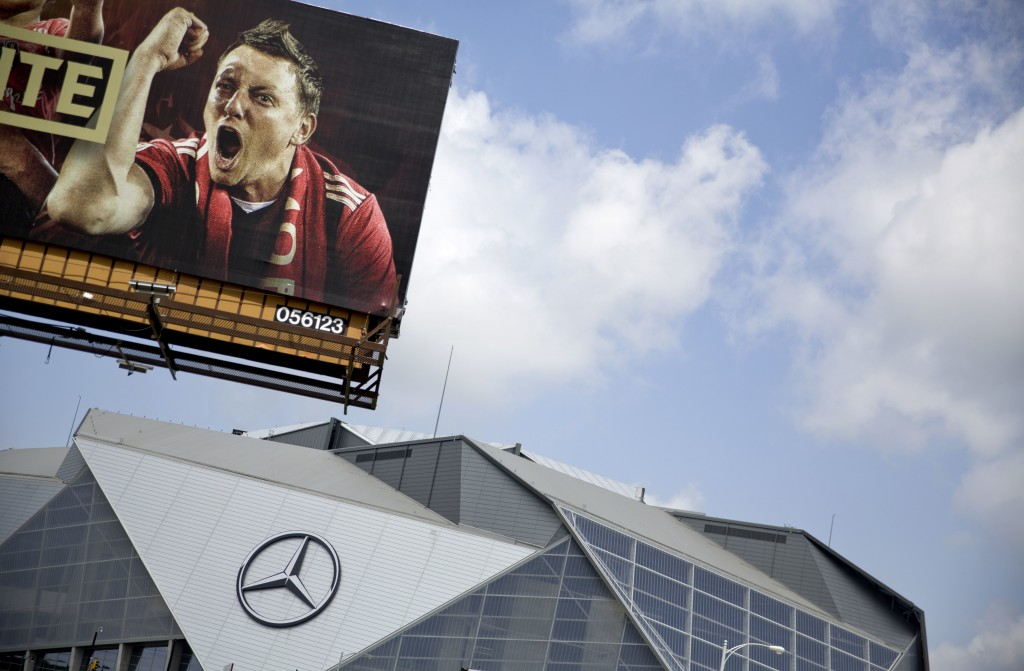 A billboard for Atlanta's MLS soccer team stands next to Mercedes-Benz Stadium where the team plays in Atlanta, Wednesday, June 13, 2018. The 2026 Wor