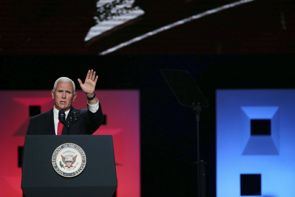 Vice President Mike Pence waves after speaking at the annual meeting of The Southern Baptist Convention at the Kay Bailey Hutchison Convention Center