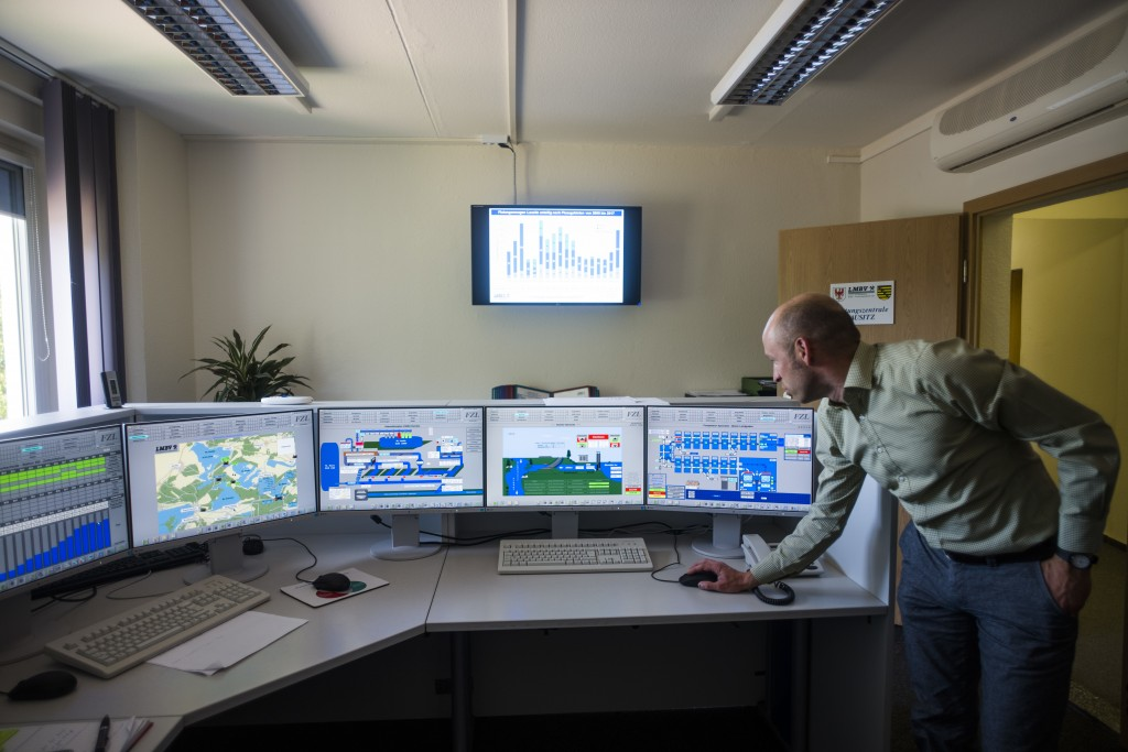 In this Wednesday, June 6, 2018, photo, engineer Soeren Albinus checks displays at the flooding management control center for lakes in the Lusatia (La