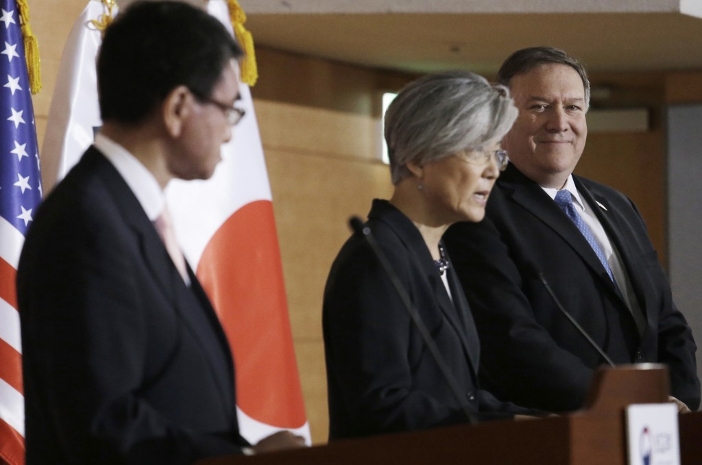 U.S. Secretary of State Mike Pompeo, right, and Japanese Foreign Minister Taro Kono, left, listen to South Korean Foreign Minister Kang Kyung-wha duri...