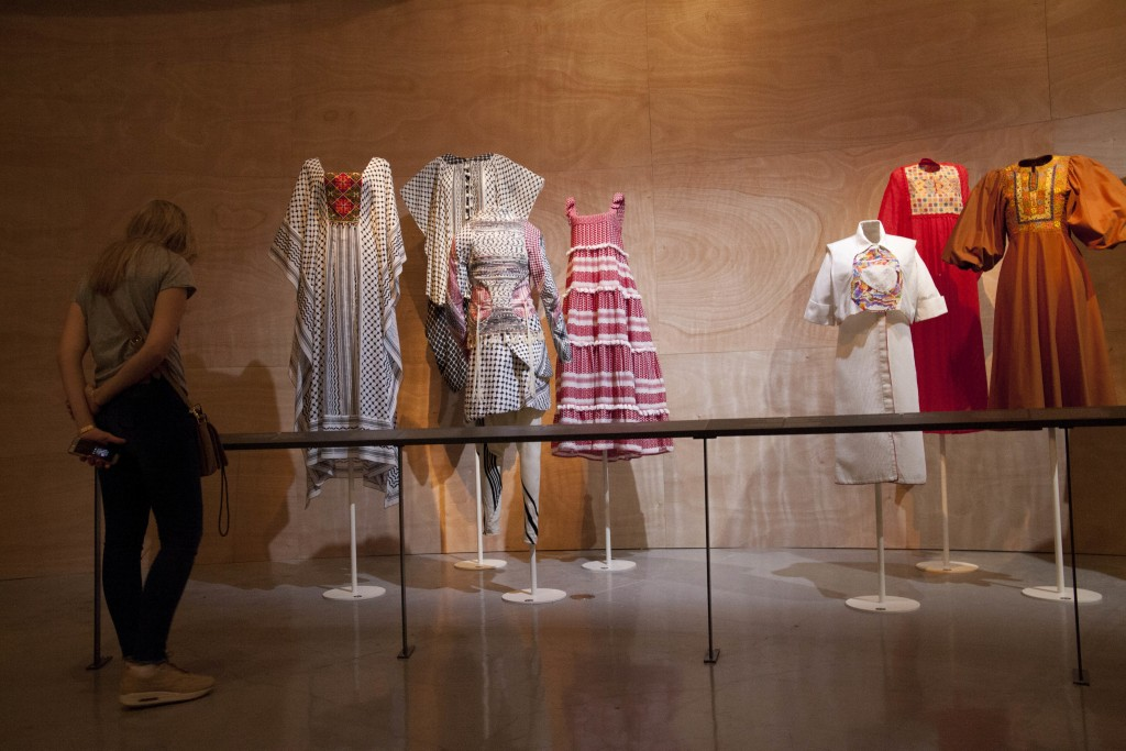 "A woman looks at ""Fashion Statements: Decoding Israeli Dress"" exhibition at Israel Museum in Jerusalem, Thursday, June 14, 2018. (AP Photo/Caron Creig"