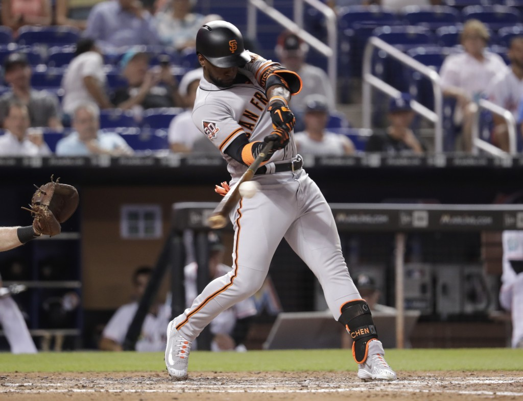 San Francisco Giants' Andrew McCutchen hits a single during the sixth inning of a baseball game against the Miami Marlins, Thursday, June 14, 2018, in
