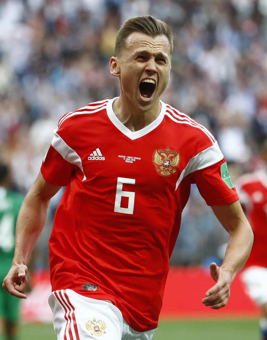 Russia's Denis Cheryshev celebrates after scoring his side's second goal during the group A match between Russia and Saudi Arabia which opens the 2018