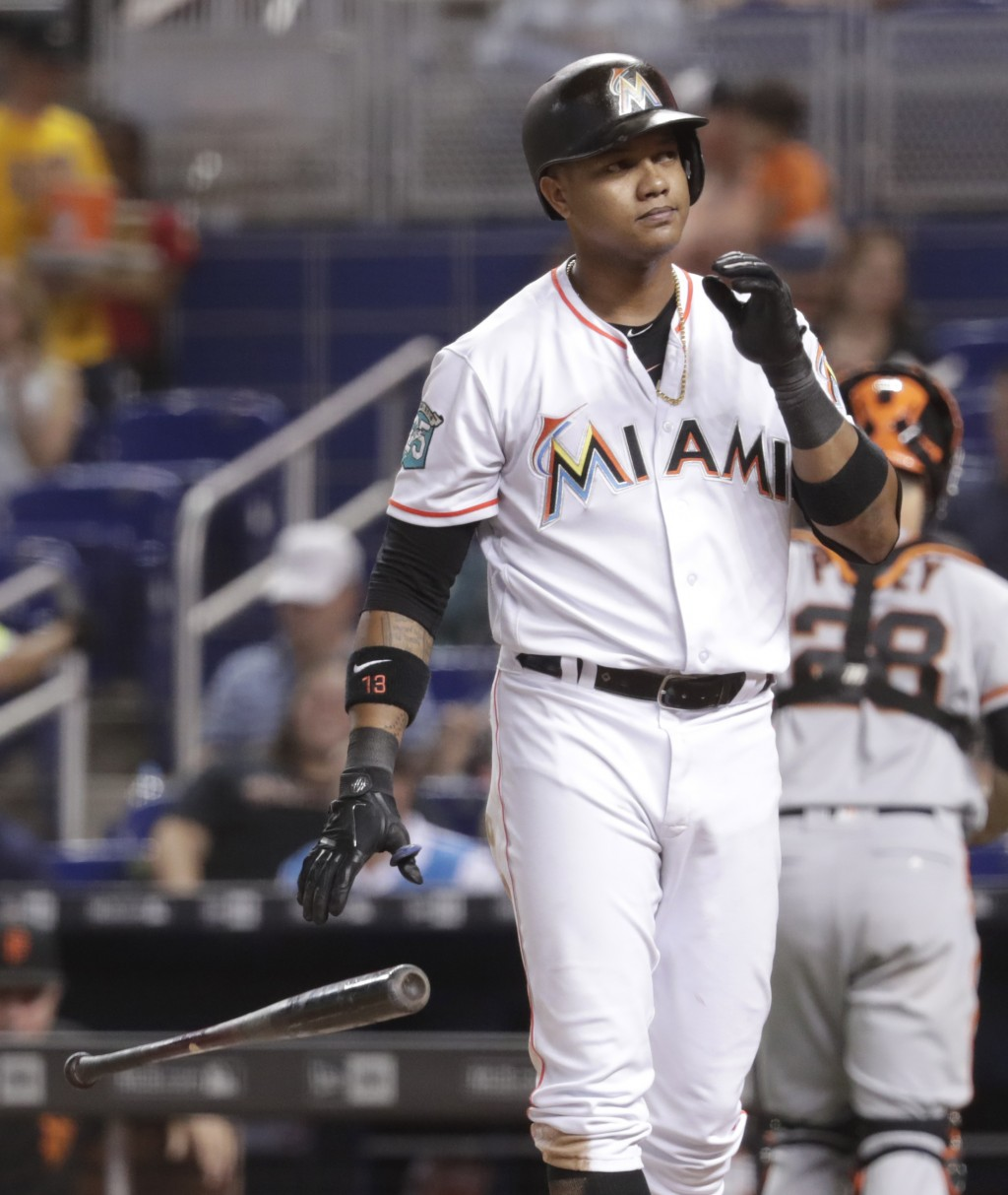 Miami Marlins' Starlin Castro drops his bat after striking out swinging in the fourth inning of a baseball game against the San Francisco Giants, Thur