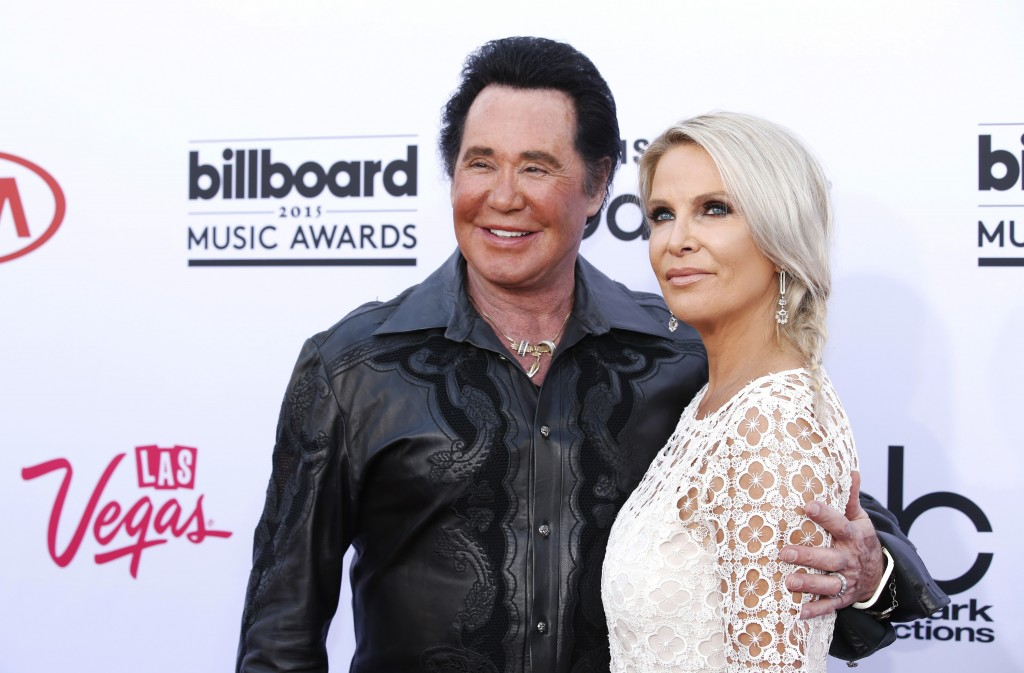 File - In this May 17, 2015 file photo, Wayne Newton, left, and his wife Kathleen McCrone arrive at the Billboard Music Awards at the MGM Grand Garden