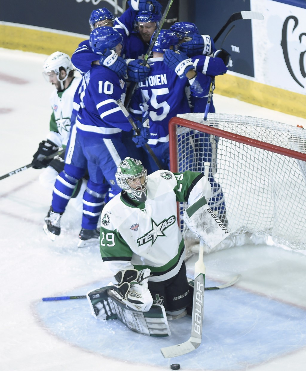 Texas Stars goaltender Mike McKenna (29) moves the puck from his net as the Toronto Marlies celebrate a goal by Andreas Johnsson during the first peri