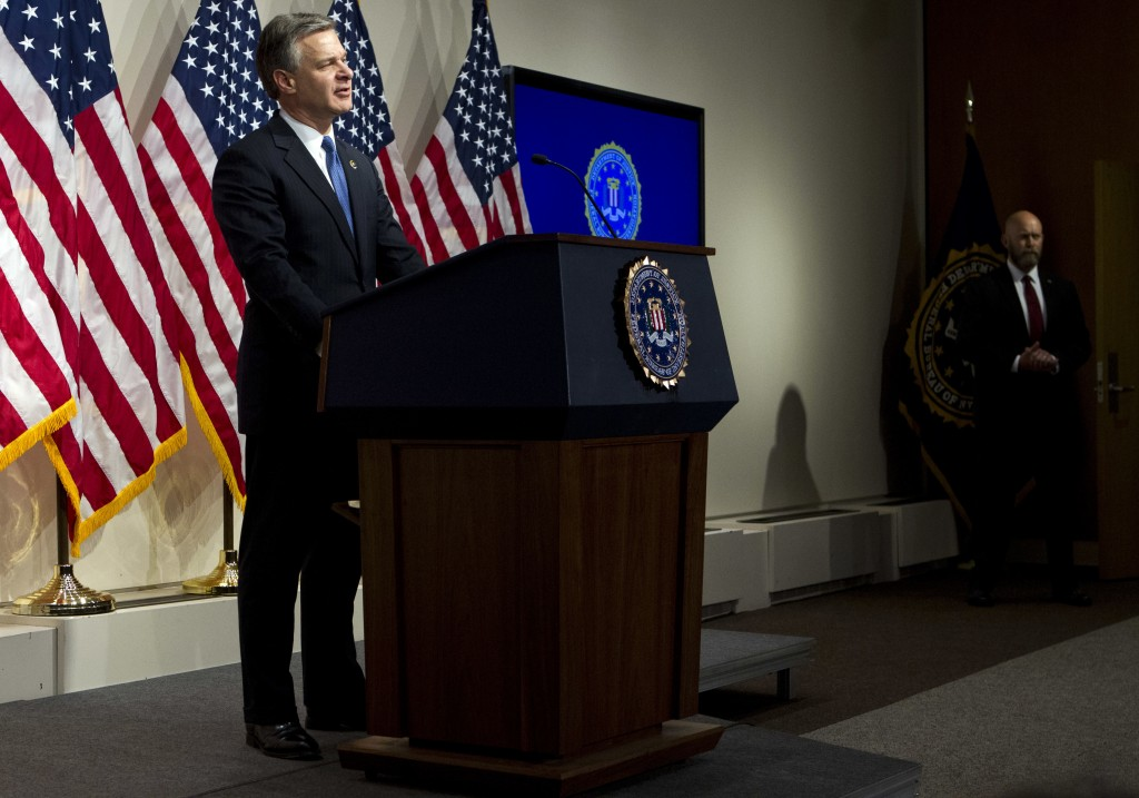 FBI Director Christopher Wray speaks during a news conference on the inspector general's report at FBI headquarters on Thursday, June 14, 2018, in Was