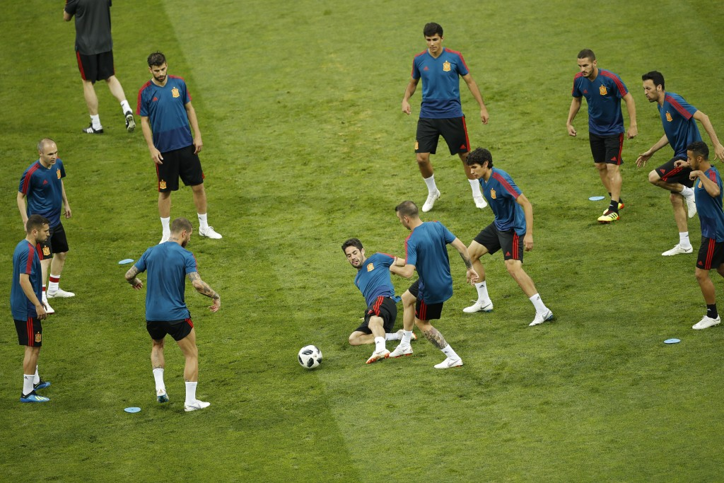 Spain players play the ball during Spain's official training on the eve of the group B match between Portugal and Spain at the 2018 soccer World Cup i