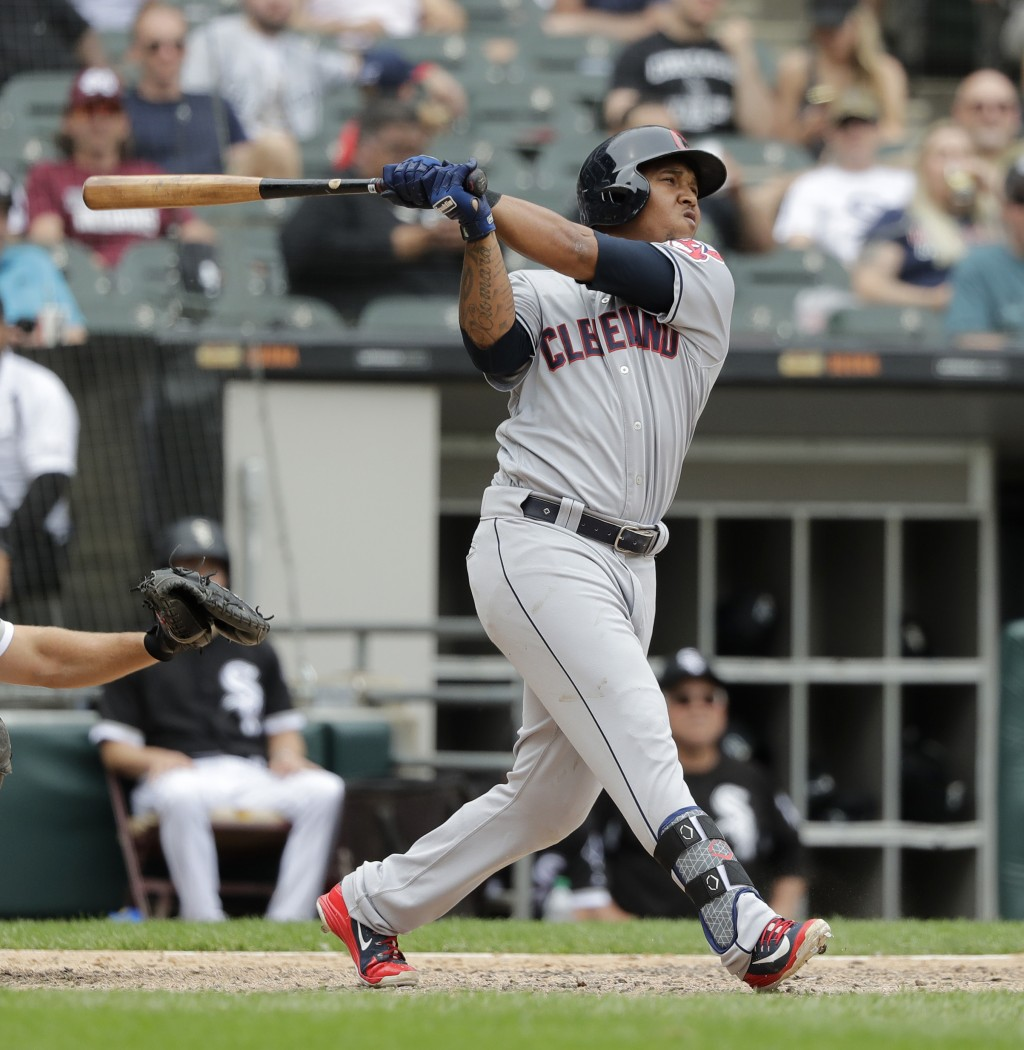 Cleveland Indians' Jose Ramirez watches his two-run home run off Chicago White Sox relief pitcher Chris Volstad during the seventh inning of a basebal