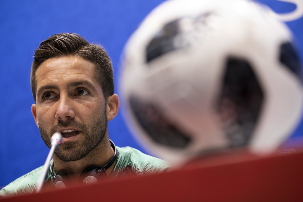 Portugal's Joao Moutinho talks to journalists during a news conference prior Portugal's official training on the eve of the group B match between Port