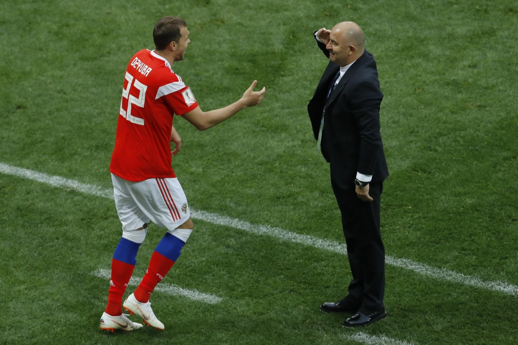 Russia head coach Stanislav Cherchesov salutes Artyom Dzyuba after he scored his side's third goal against Saudi Arabia in the group A match which ope