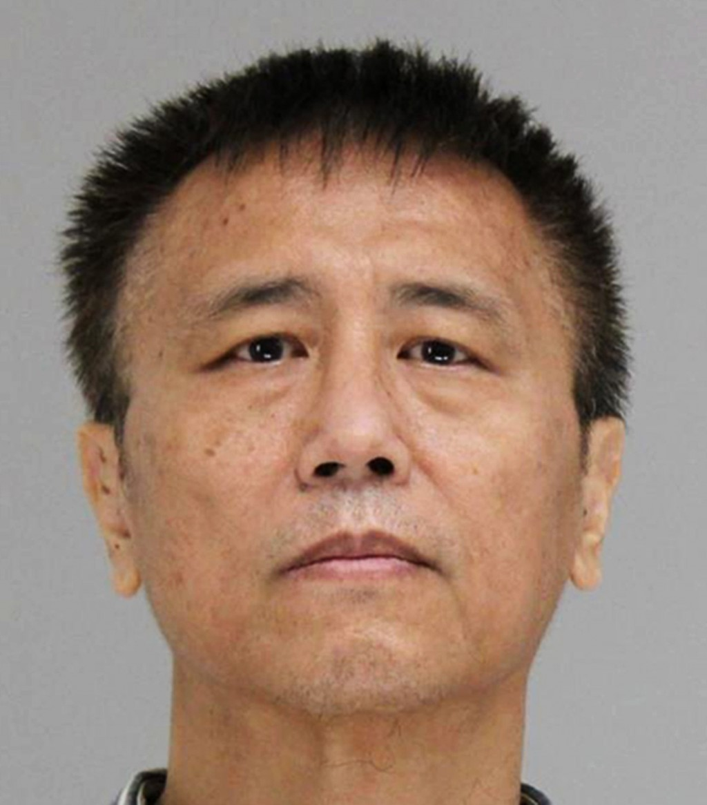 This photo provided by the Dallas County Jail shows George Guo, who is being held Thursday, June 14, 2018, on a capital murder charge. Prosecutors in