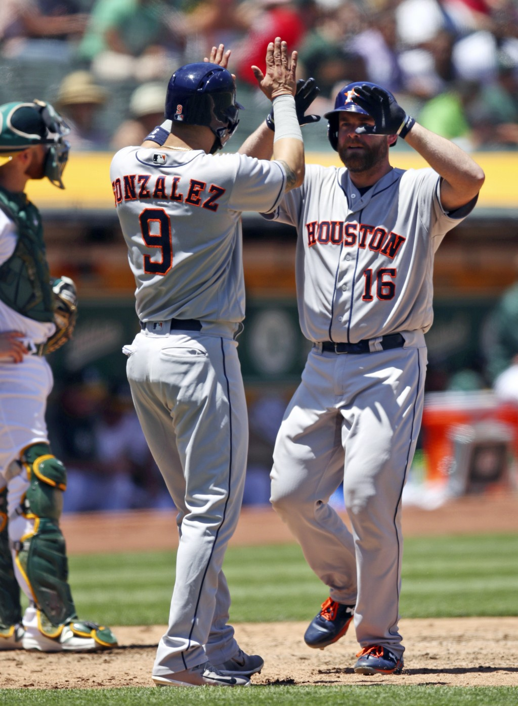 Houston Astros' Brian McCann, right, celebrates with Marwin Gonzalez (9) after hitting a two-run home run off Oakland Athletics' Frankie Montas in the