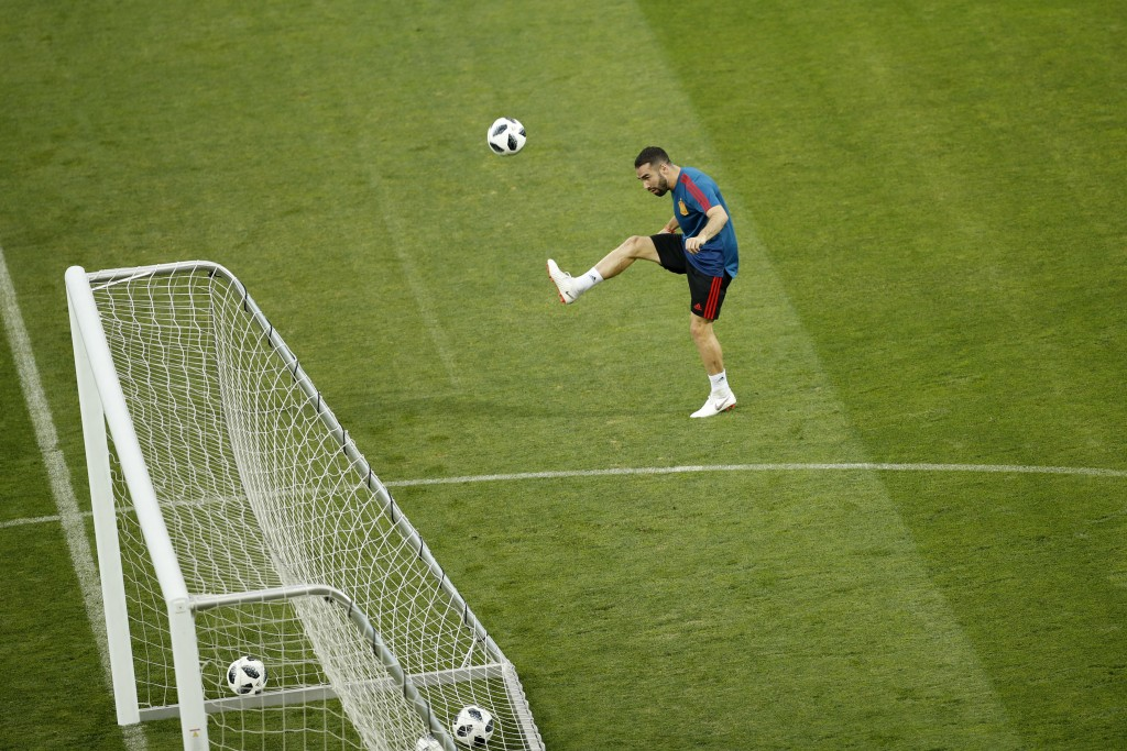 Spain's Dani Carvajal shoots the ball during Spain's official training on the eve of the group B match between Portugal and Spain at the 2018 soccer W
