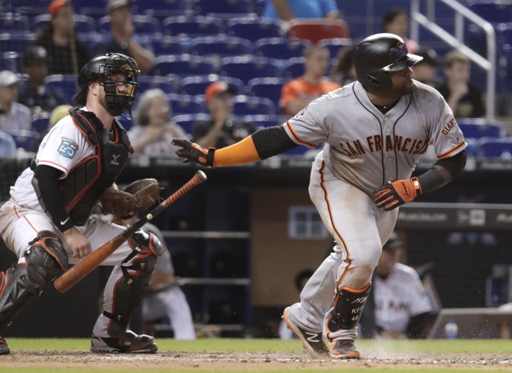 San Francisco Giants' Pablo Sandoval, right, watches after hitting an RBI single to score two runs during the 16th inning of a baseball game against t