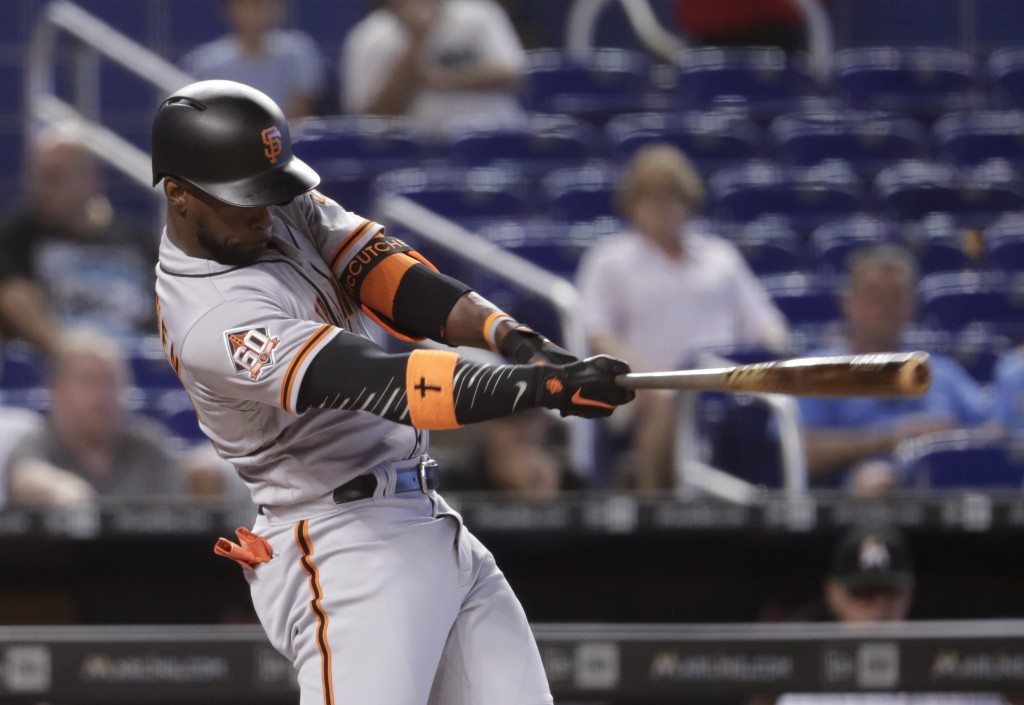 San Francisco Giants' Andrew McCutchen hits a two-run home run during the first inning of a baseball game against the Miami Marlins, Thursday, June 14