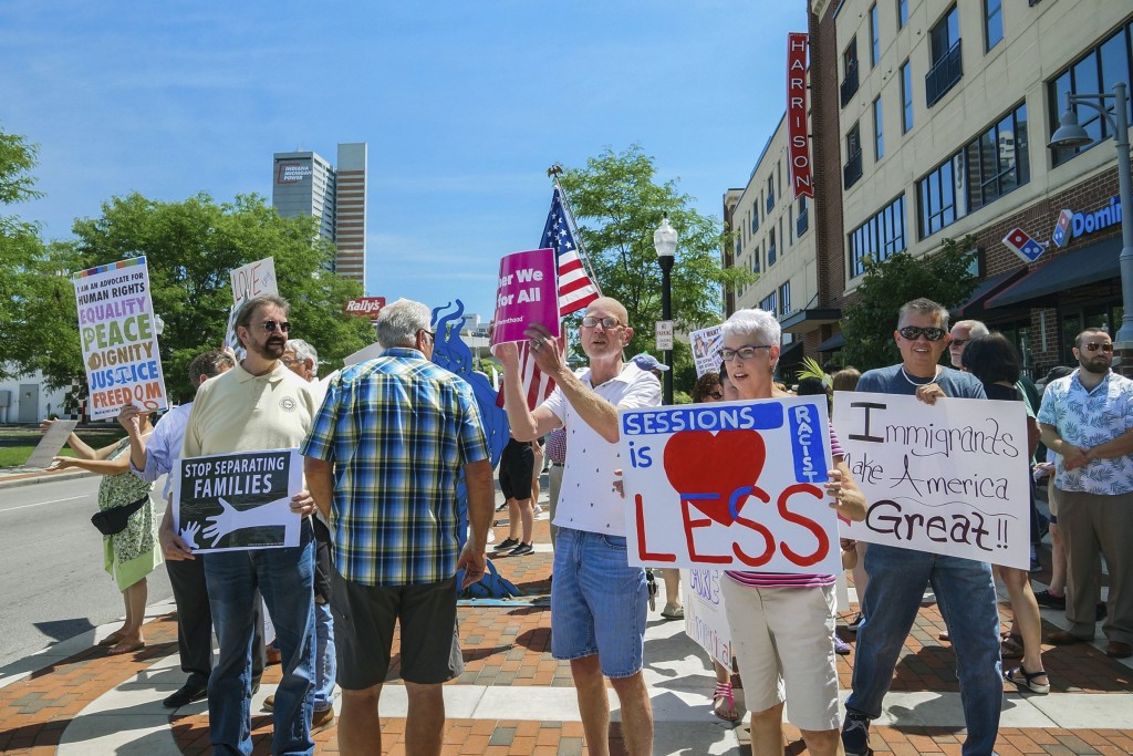 People gather to protest U.S. Attorney General Jeff Sessions and immigration reform at Parkview Field in Fort Wayne, Ind., Thursday, June 14, 2018. (M