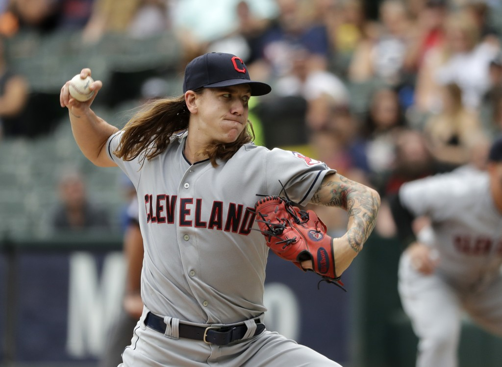 Cleveland Indians starting pitcher Mike Clevinger delivers during the first inning of a baseball game against the Chicago White Sox Thursday, June 14,