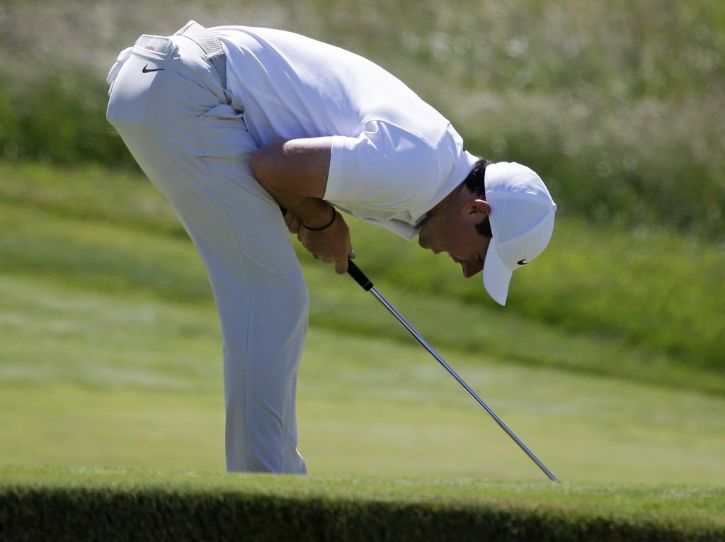 Rory McIlroy of Northern Ireland reacts after missing a putt on the 18th hole during the first round of the U.S. Open Golf Championship, Thursday, Jun