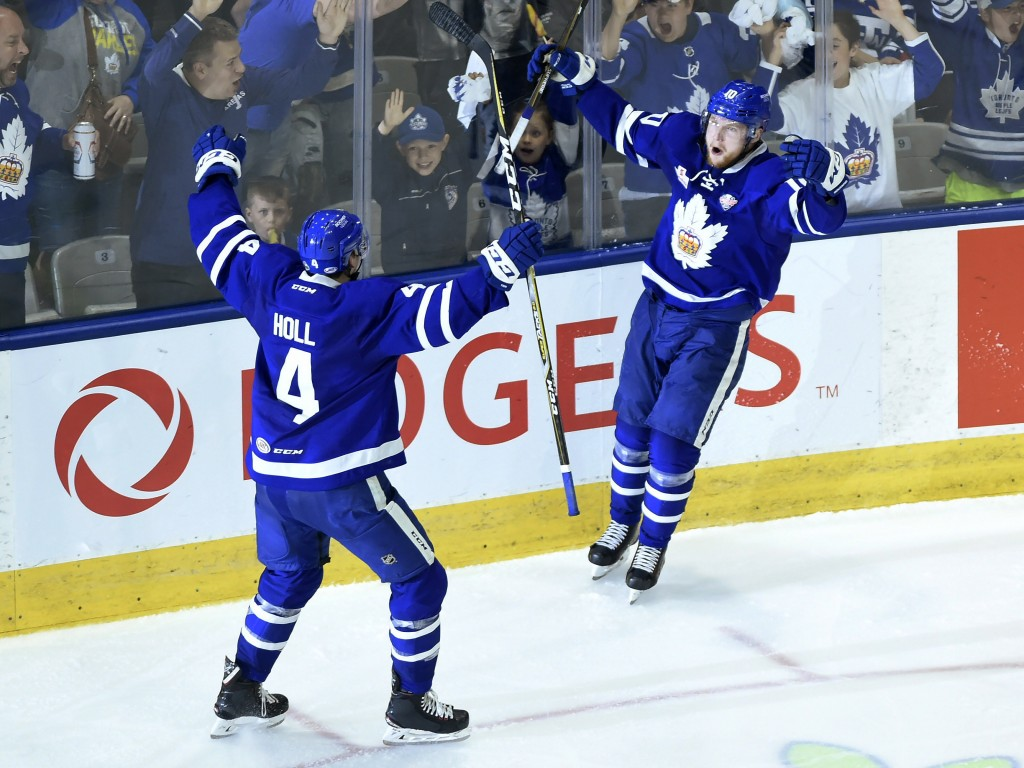 Toronto Marlies' Carl Grundstrom celebrates his goal with teammate Justin Holl (4) during the third period of Game 7 of the AHL Calder Cup final again