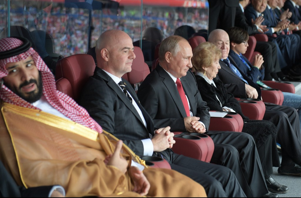 From left, Saudi Arabia Crown Prince Mohammed bin Salman, FIFA President Gianni Infantino, and Russian President Vladimir Putin watch the match betwee