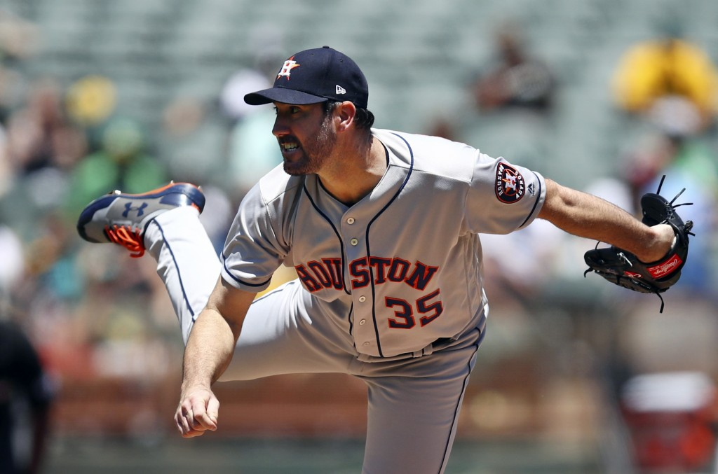 Houston Astros pitcher Justin Verlander works against the Oakland Athletics in the first inning of a baseball game Thursday, June 14, 2018, in Oakland