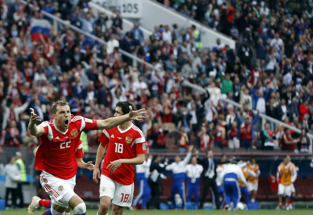 Russia's Artyom Dzyuba celebrates after scoring his side's third goal during the group A match between Russia and Saudi Arabia which opens the 2018 so