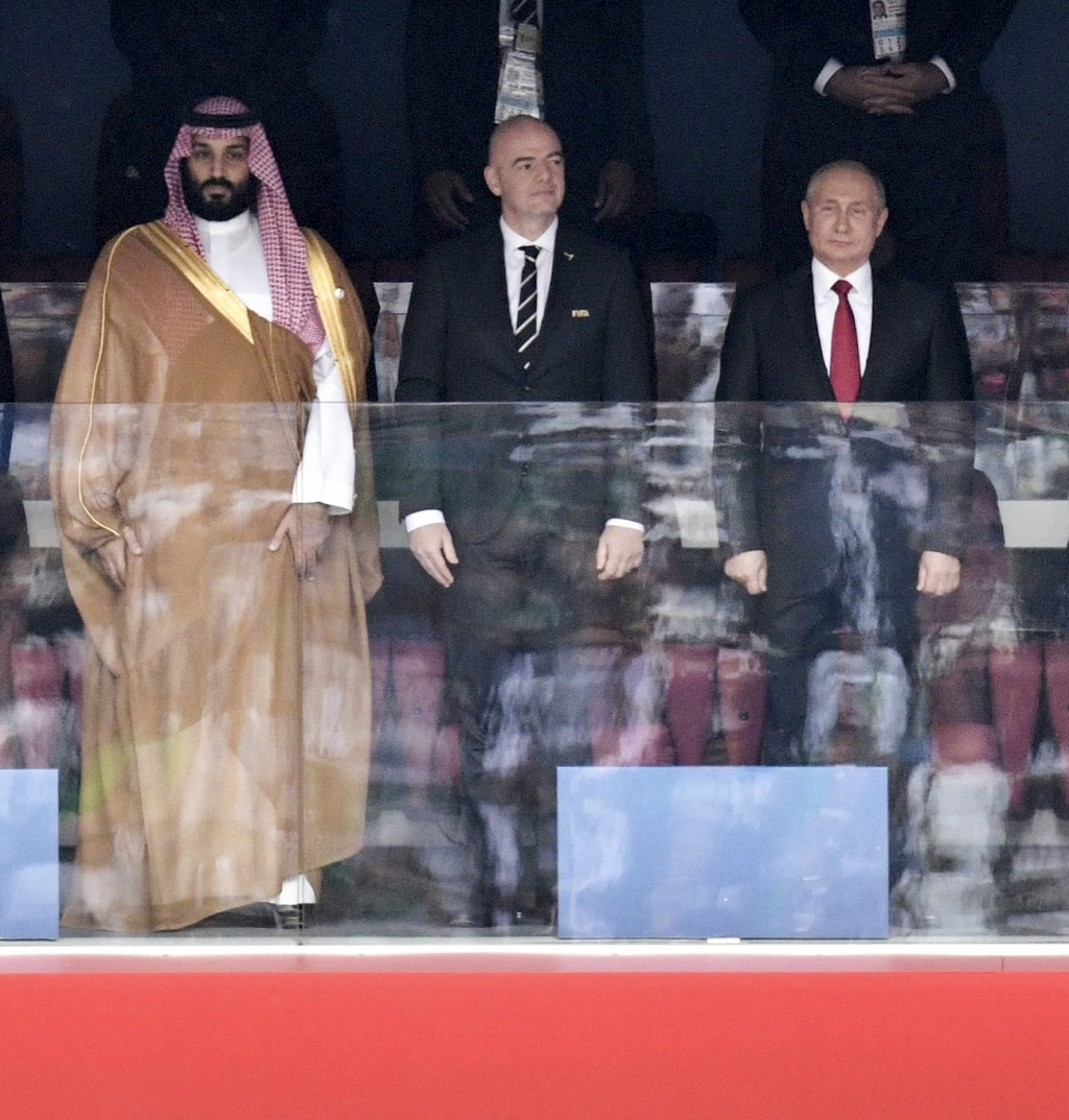Saudi Arabia Crown Prince Mohammed bin Salman, left, FIFA President Gianni Infantino, center, and Russian President Vladimir Putin stand for the anthe