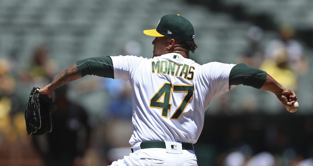 Oakland Athletics pitcher Frankie Montas works against the Houston Astros in the first inning of a baseball game Thursday, June 14, 2018, in Oakland,