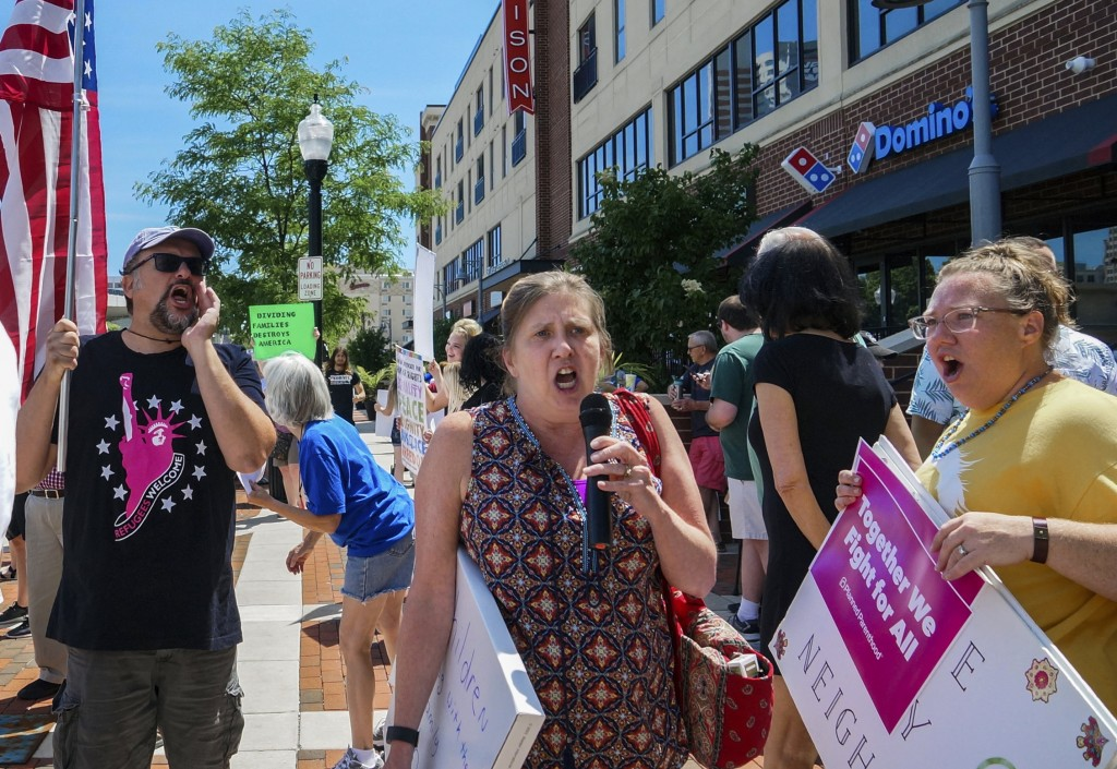 People shout while protesting against U.S. Attorney General Jeff Sessions and immigration reform at Parkview Field in Fort Wayne, Ind., Thursday, June