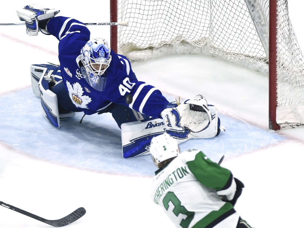 Toronto Marlies goaltender Garret Sparks (40) makes the save, deflecting the puck over the net on a shot from Texas Stars defenseman Dillon Heathering
