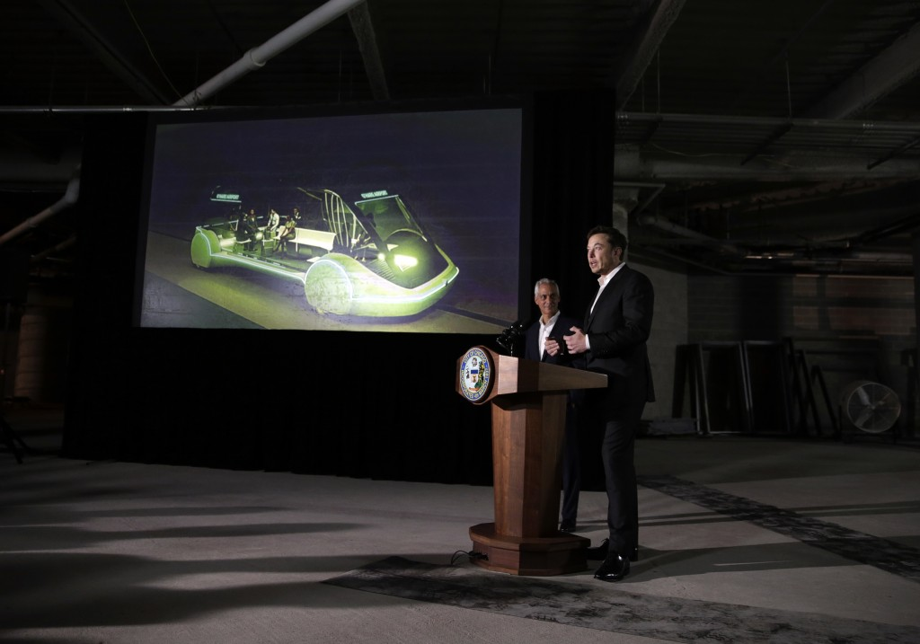 Tesla CEO and founder of the Boring Company Elon Musk, right, and Mayor Rahm Emanuel speak at a news conference, Thursday, June 14, 2018, in Chicago.
