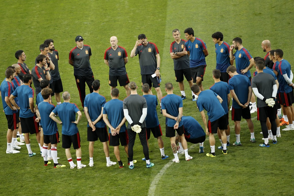 Spain head coach Fernando Hierro, top centre, touches his forehead as gives instructions to his players during Spain's official training on the eve of