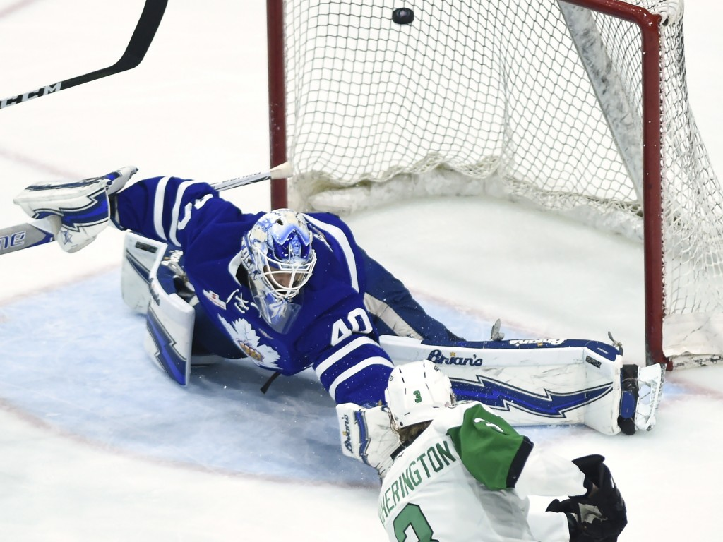 Toronto Marlies goaltender Garret Sparks (40) makes the save deflecting the puck over the net on a shot from Texas Stars defenseman Dillon Heatheringt