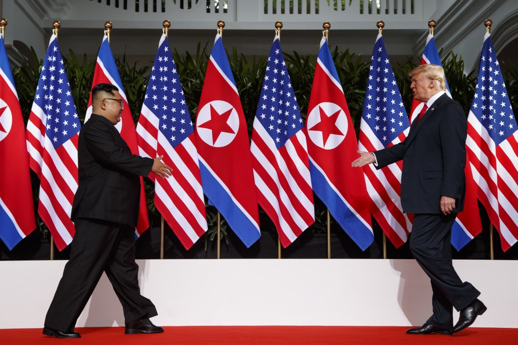 In this June 12, 2018, photo, President Donald Trump meets with North Korean leader Kim Jong Un on Sentosa Island in Singapore. Trump credits his acco...