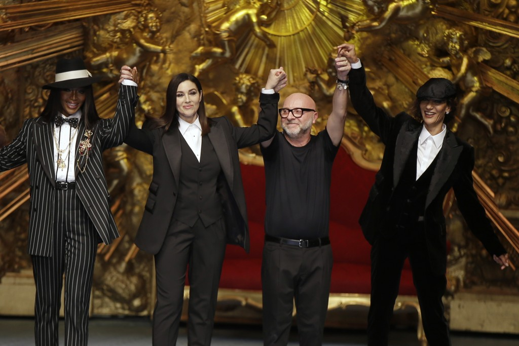 cdb950519 Model Naomi Campbell, from left, actress Monica Bellucci and designer  Domenico Dolce accept applause