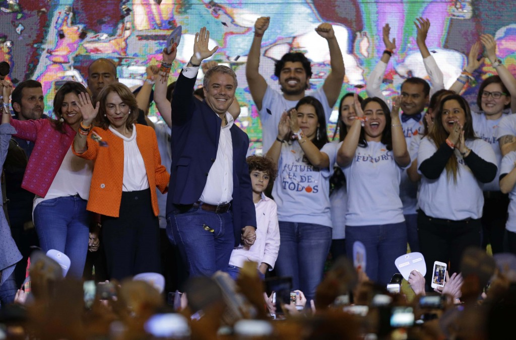 Colombia's President Elect Ivan Duque celebrates his victory in the presidential runoff election, in Bogota, Colombia, Sunday, June 17, 2018. Duque de...
