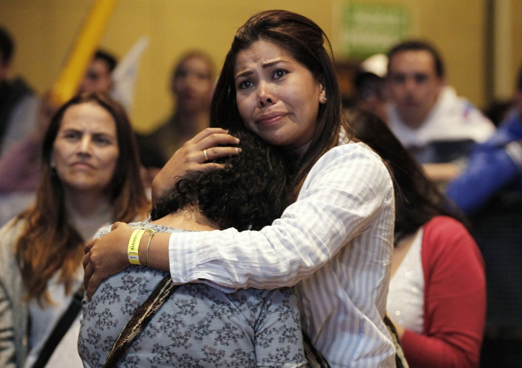 Supporters of Gustavo Petro, presidential candidate for Colombia Humana, cry as results of the vote count come in, giving an early advantage to his ri...