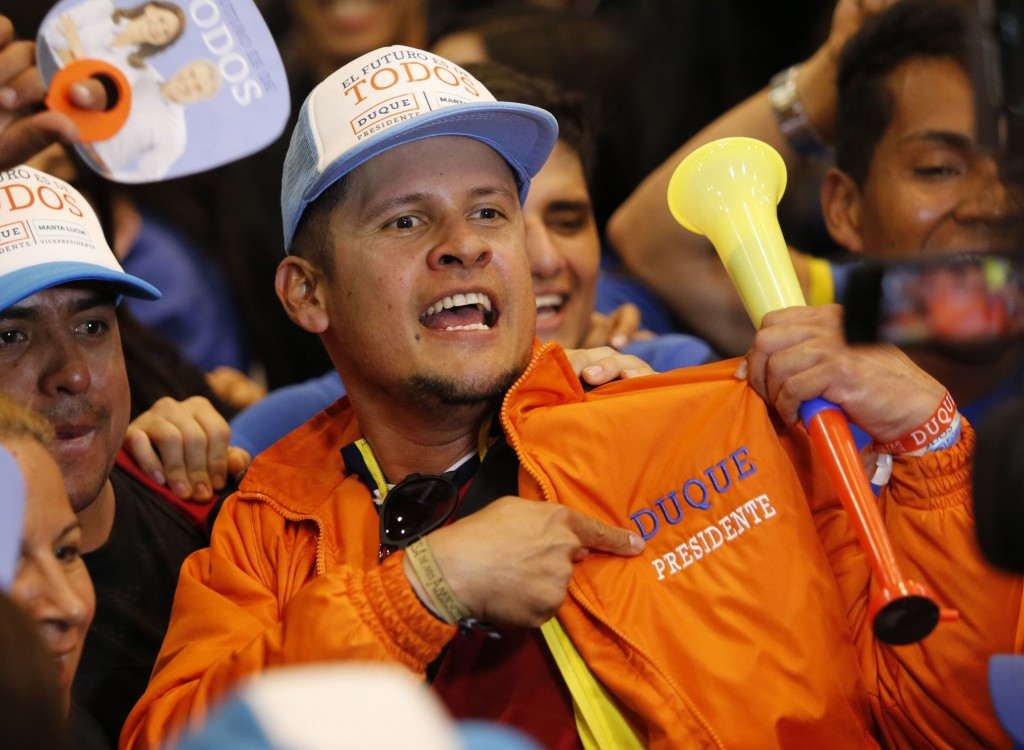 Supporters of Ivan Duque, candidate of the Democratic Centre party, celebrate his victory in the presidential runoff election in Bogota, Colombia, Sun...