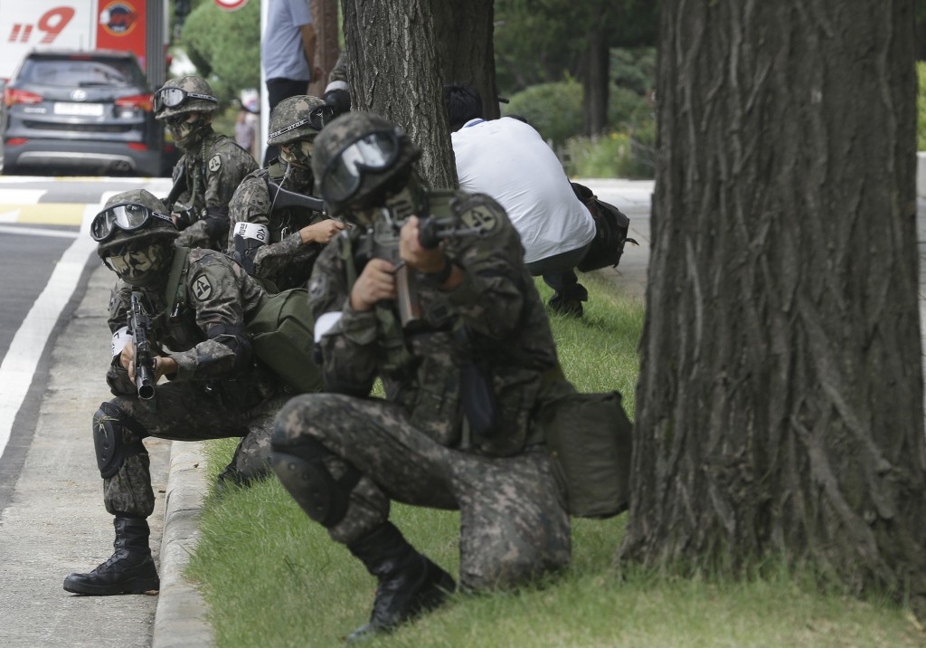 FILE - In this Aug. 24, 2016 file photo, South Korean army soldiers conduct an anti-terror drill as part of Ulchi Freedom Guardian exercise, at the Na