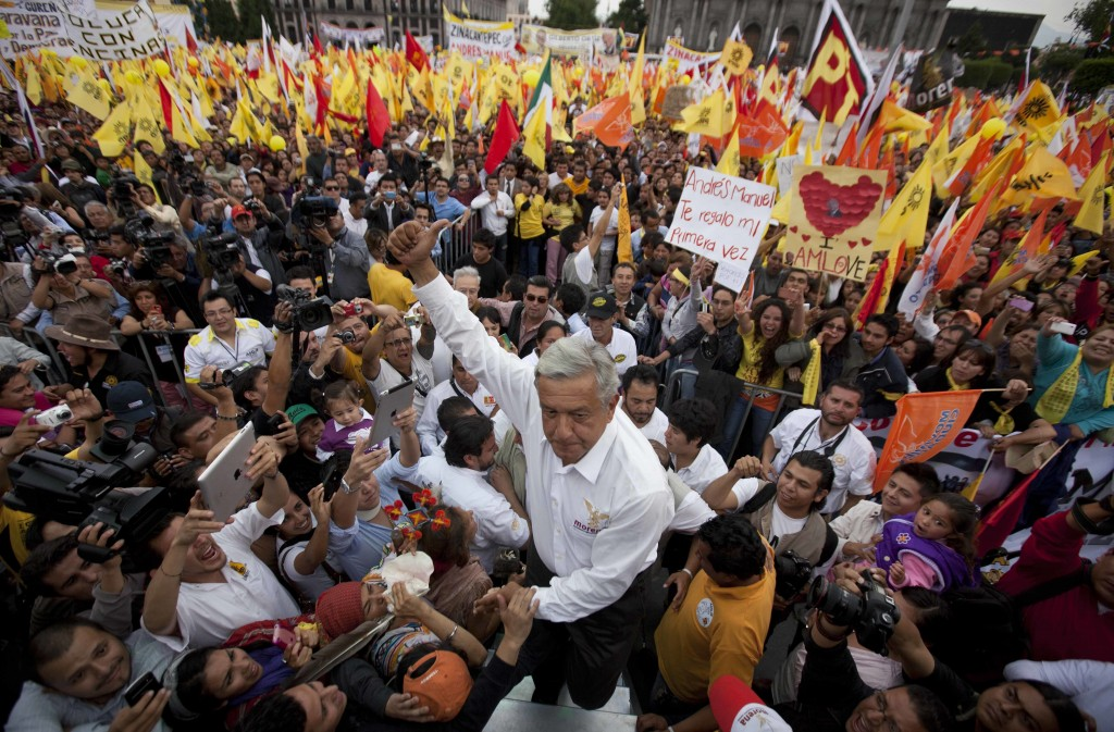 FILE - In this June 26, 2012 file photo, Andres Manuel Lopez Obrador, presidential candidate of the Democratic Revolution Party, PRD, greets supporter...