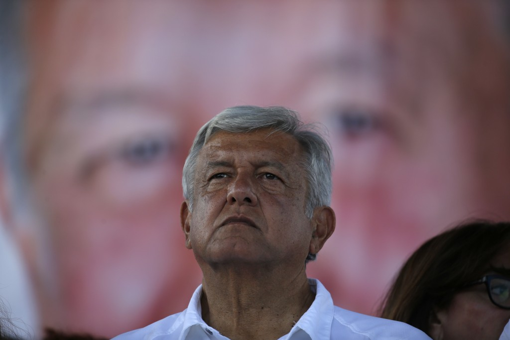 Mexico's presidential candidate Andres Manuel Lopez Obrador of the MORENA party leads a campaign rally in Ecatepec, Mexico, Sunday, June 17, 2018. Lop...