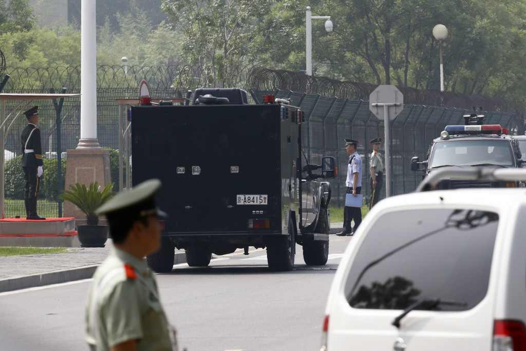 Paramilitary policemen and policemen stand guard at the main entrance gate of the VIP gate of Beijing Capital International Airport as they prepare fo...