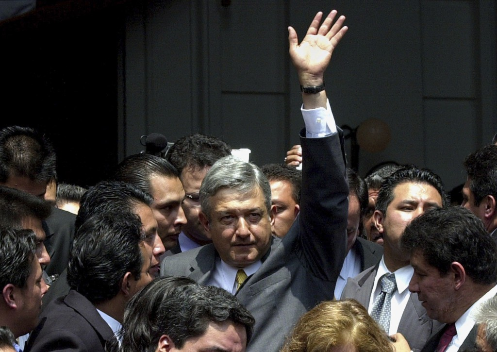 FILE - In this Sept. 17, 2002 file photo, Mexico City Mayor Andres Manuel Lopez Obrador waves after delivering his state of the city address in Mexico...