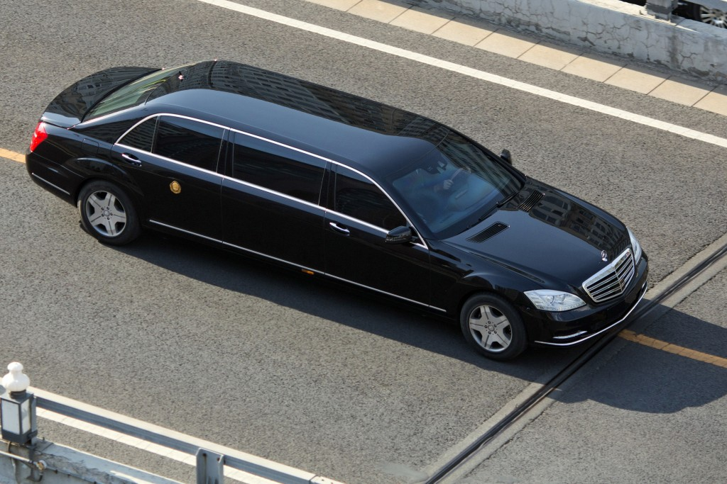 A stretch limousine with a golden emblem similar to one North Korean leader Kim Jong Un has used previously, travels along a road closed to other traf...