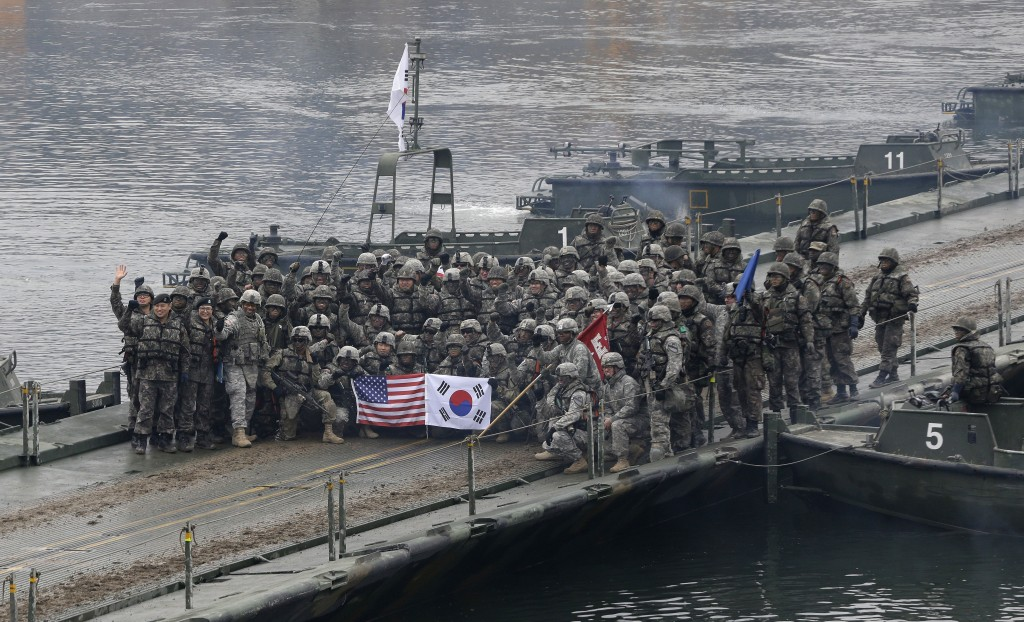 FILE - In this Dec. 10, 2015 file photo, U.S. and South Korean army soldiers pose on a floating bridge on the Hantan river after a river crossing oper...